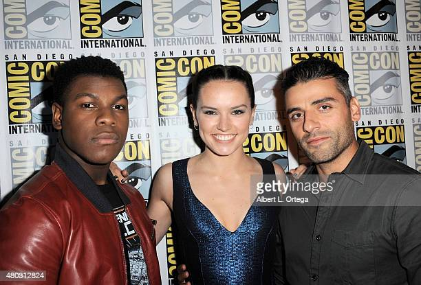 Actors John Boyega Daisy Ridley and Oscar Isaac attend the Lucasfilm panel during ComicCon International 2015 at the San Diego Convention Center on...