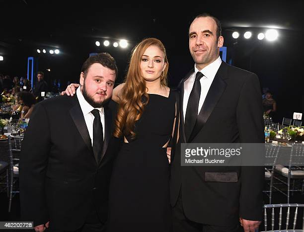 Actors John BradleyWest Sophie Turner and Rory McCann attend TNT's 21st Annual Screen Actors Guild Awards cocktail reception at The Shrine Auditorium...