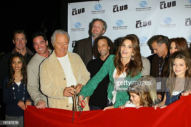 Actors John C McGinley Dean Cain Daniel Stern musician Kenny G and supermodel Cindy Crawford cut the red ribbon to officially launch The Club at the...
