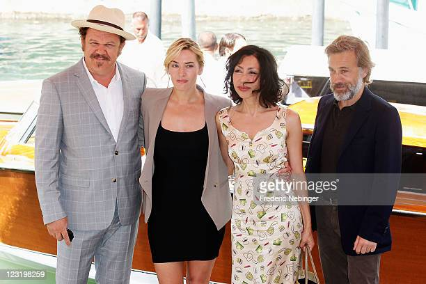 Actors John C Reilly Kate Winslet writerYasmina Reza and Christoph Waltz arrive at the Carnage photocall during the 68th Venice Film Festival at the...