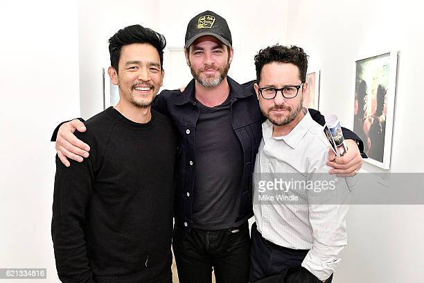 Actors John Cho Chris Pine and director JJ Abrams attends the opening of the Anton Yelchin photography exhibit at Other Gallery on November 5 2016 in...