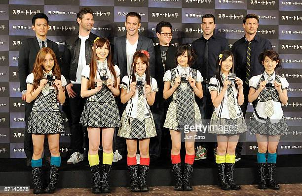 Actors John Cho Eric Bana Chris Pine Director JJ Abrams actors Zachary Quinto and Karl Urban pose with Japanese pop group AKB48 during the 'Star...