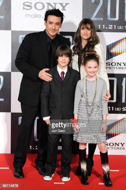 Actors John Cusack Liam James Amanda Peet and Morgan Lily attend 2012 Japan Premiere at Roppongi Hills Arena on November 17 2009 in Tokyo Japan The...