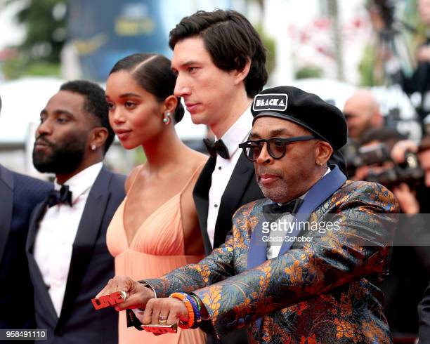 Actors John David Washington Laura Harrier Adam Driver and director Spike Lee who wears knuckle rings with love and hate on them as they attend the...