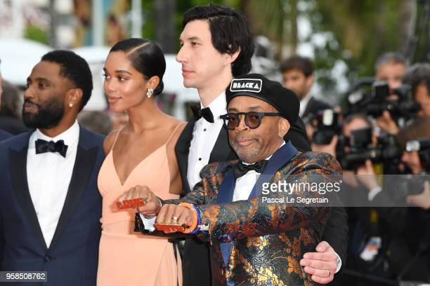 Actors John David Washington Laura Harrier Adam Driver director Spike Lee who wears knuckle rings with love and hate on them attend the screening of...