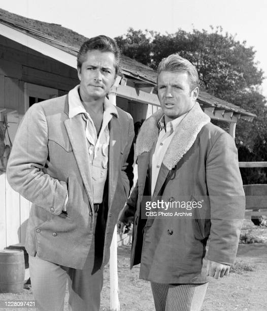 """Actors John Derek and Richard Jaeckel are photographed on the set of the CBS television series """"Frontier Circus"""" on January 18 in Los Angeles,..."""