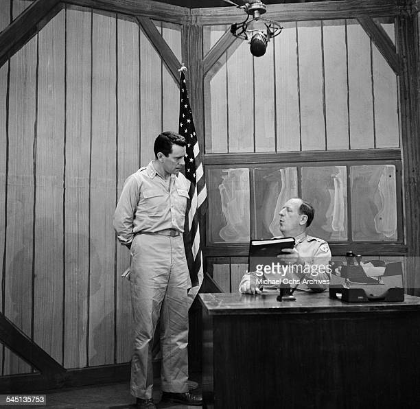 Actors John Forsythe and Paul Ford enact a scene from the Broadway production of 'Teahouse of the August Moon' on the 'Toast of the Town' show hosted...