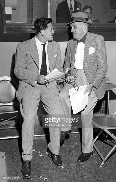 Actors John Garfield and veteran performer Al Jolson discuss the script before their appearance on the CBS radio charity broadcast UNITED JEWISH...