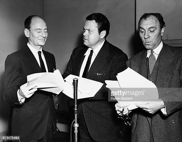 Actors John Gielgud Orson Welles as Professor Moriaty and Ralph Richardson recording a BBC radio production of Sherlock Holmes 1954