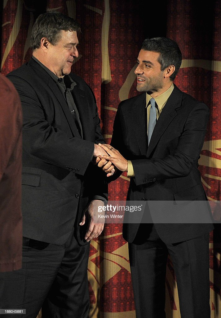 Actors John Goodman (L) and Oscar Isaac onstage during the AFI Premiere Screening of 'Inside Llewyn Davis' at TCL Chinese Theatre on November 14, 2013 in Hollywood, California.