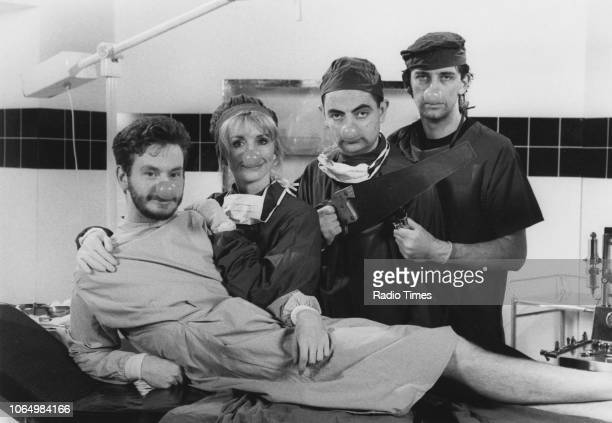 Actors John Gordon Sinclair Jane Asher Rowan Atkinson and Jimmy Nail wearing hospital gowns and false red noses photographed for Radio Times in...