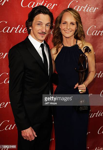 Actors John Hawkes and Helen Hunt pose with the Spotlight Award at the 24th annual Palm Springs International Film Festival Awards Gala at the Palm...