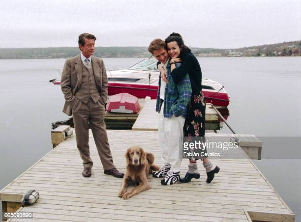 Actors John Hurt in a suit and tie Jason Priestley wearing sneakers and comfortable clothes and Fiona Loewi wearing clogs and heavy wool socks with a...