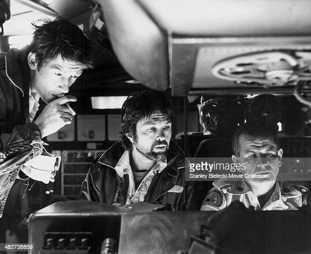 Actors John Hurt, Tom Skerritt and Veronica Cartwright in a scene from the movie 'Alien', 1979.