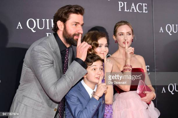 """Actors John Krasinski, Noah Jupe, Millicent Simmonds and Emily Blunt attend the """"A Quiet Place"""" New York Premiere at AMC Lincoln Square Theater on..."""