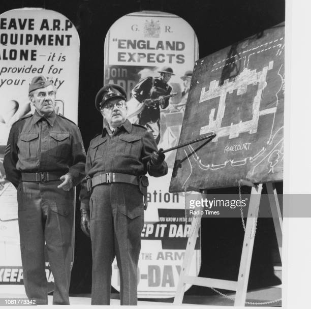 Actors John Le Mesurier and Arthur Lowe inspecting a map of Buckingham Palace on stage as part of the 'Dad's Army' sketch at BBC 'The Royal...