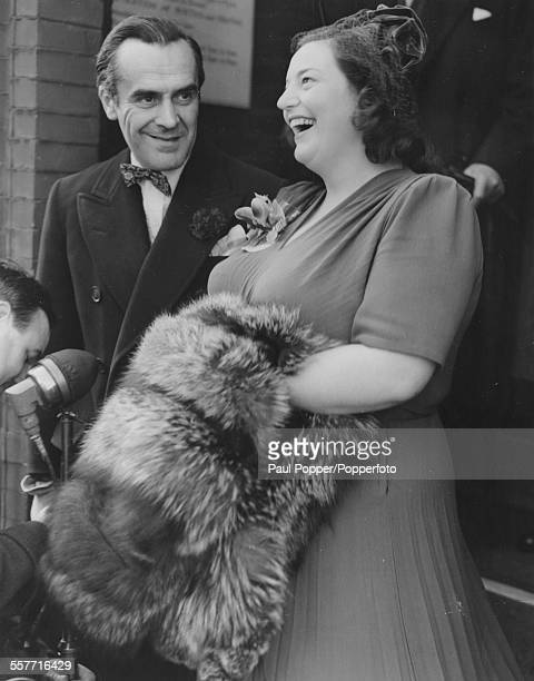 Actors John le Mesurier and Hattie Jacques smiling outside the church on their wedding day at Kensington Registry Office London November 10th 1949