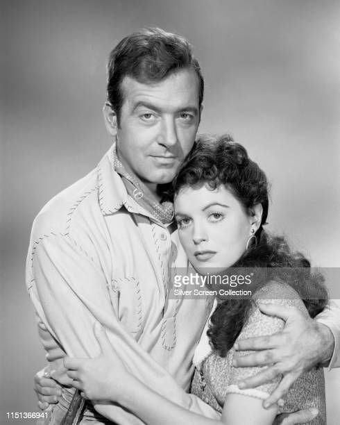 Actors John Payne as Kirby Randolph and Faith Domergue as Aurelie St Clair in a promotional shot for the Western 'Santa Fe Passage' 1955