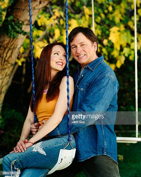 Actors John Ritter and Amy Yasbeck are photographed for InStyle Magazine in 2003 at home in Los Angeles California PUBLISHED IMAGE