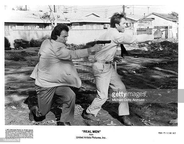 Actors John Ritter and James Belushi on the set of the United movie Real Men in 1987