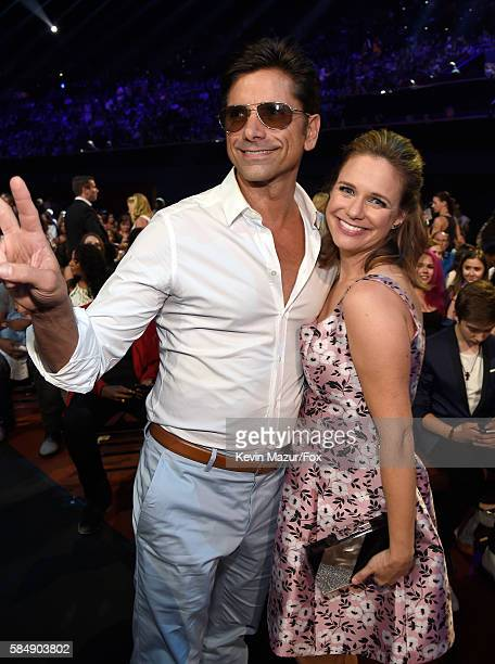 Actors John Stamos and Andrea Barber attend the Teen Choice Awards 2016 at The Forum on July 31 2016 in Inglewood California