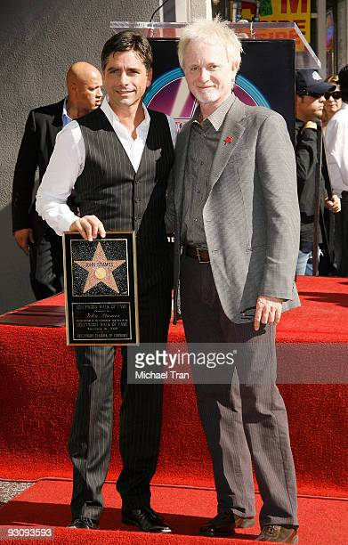 Actors John Stamos and Anthony Geary attend the ceremony honoring Actor John Stamos with a star on the Hollywood Walk of Fame on November 16 2009 in...