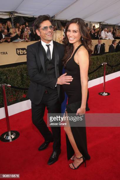 Actors John Stamos and Caitlin McHugh attend the 24th Annual Screen ActorsGuild Awards at The Shrine Auditorium on January 21 2018 in Los Angeles...