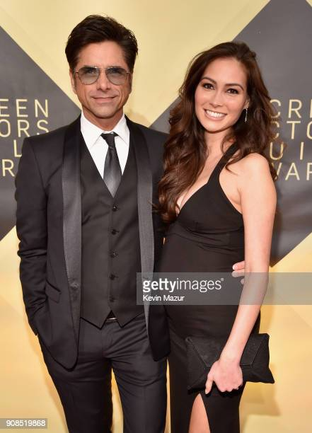 Actors John Stamos and Caitlin McHugh attend the 24th Annual Screen Actors Guild Awards at The Shrine Auditorium on January 21 2018 in Los Angeles...