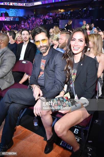 Actors John Stamos and Caitlin McHugh pose at Nickelodeon's 2017 Kids' Choice Awards at USC Galen Center on March 11 2017 in Los Angeles California