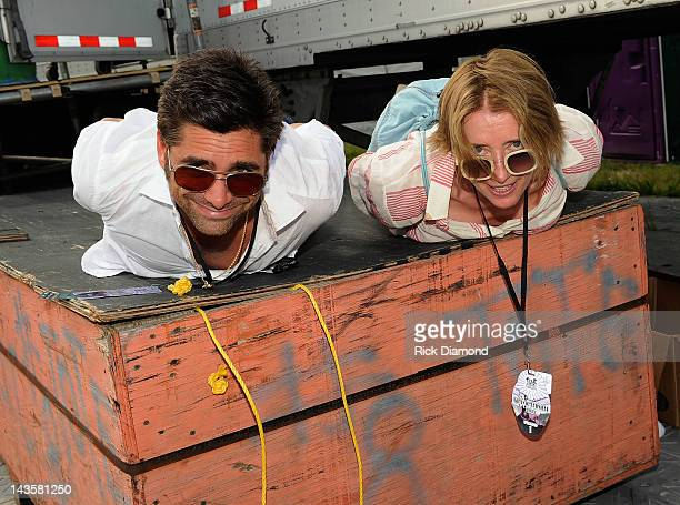 Actors John Stamos and Emma Thompson backstage during the 2012 New Orleans Jazz Heritage Festival Day 3 at the Fair Grounds Race Course on April 29...