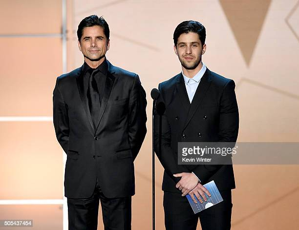 Actors John Stamos and Josh Peck speak onstage during the 21st Annual Critics' Choice Awards at Barker Hangar on January 17 2016 in Santa Monica...