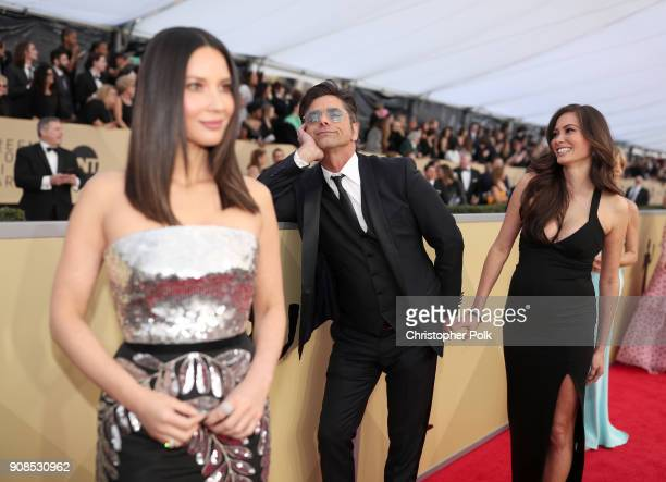 Actors John Stamos Olivia Munn and Caitlin McHugh attends the 24th Annual Screen Actors Guild Awards at The Shrine Auditorium on January 21 2018 in...