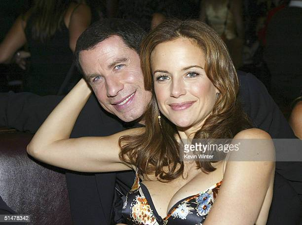 Actors John Travolta and his wife Kelly Preston pose at the after party for the premiere of Lions Gates' Eulogy at the Palomino Restaurant on October...