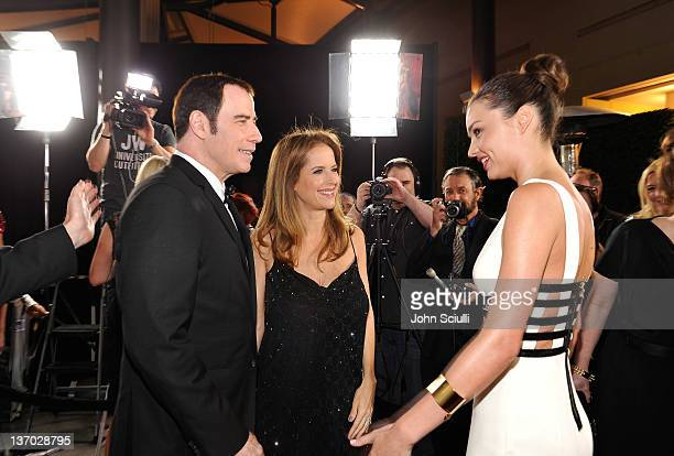 Actors John Travolta and Kelly Preston and model Miranda Kerr arrive at the 9th Annual G'Day USA Los Angeles Black Tie Gala at the Hollywood Highland...