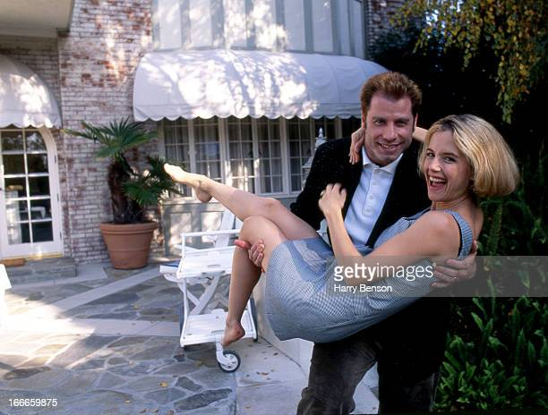 Actors John Travolta and Kelly Preston are photographed for People Magazine in 1994 at home in Belair California