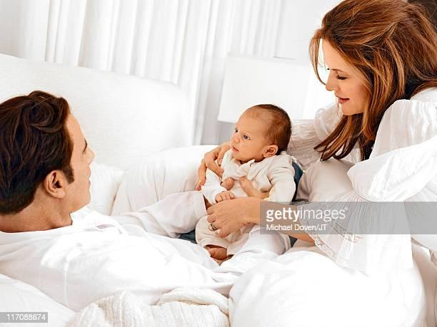 Actors John Travolta and Kelly Preston with their newborn son Benjamin Travolta at their home in Florida on January 4 2011