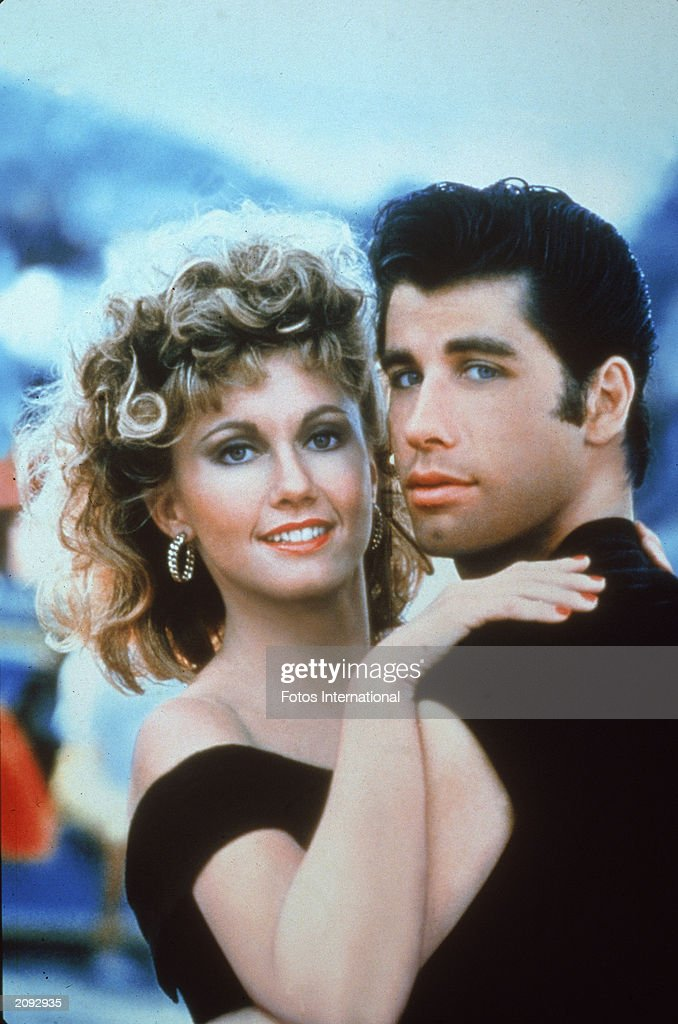 Actors John Travolta and Olivia Newton-John embrace in a promotional still for the film, 'Grease,' directed by Randal Kleiser, 1978.