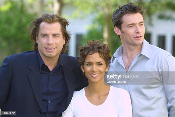 Actors John Travolta Halle Berry and Hugh Jackman publicise their new film 'Swordfish' at the Four Seasons Hotel Canary Wharf London June 25 2001