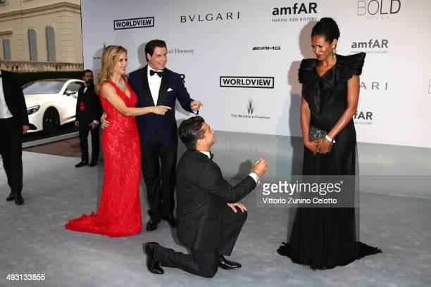Actors John Travolta, Kelly Preston, producer Oscar Generale and Danny Mendez attend amfAR's 21st Cinema Against AIDS Gala Presented By WORLDVIEW,...