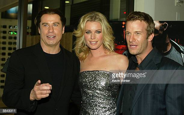 """Actors John Travolta, Rebecca Romijn-Stamos and Thomas Jane attend the Los Angeles premiere of the Lion's Gate film """"The Punisher"""" at the ArcLight..."""