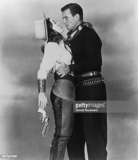 Actors John Wayne and Ella Raines on the movie set of Tall in the Saddle directed by Edwin L Marin