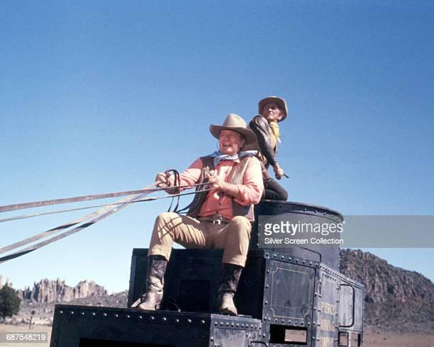 Actors John Wayne as Taw Jackson and Kirk Douglas as Lomax in the western film 'The War Wagon' 1967