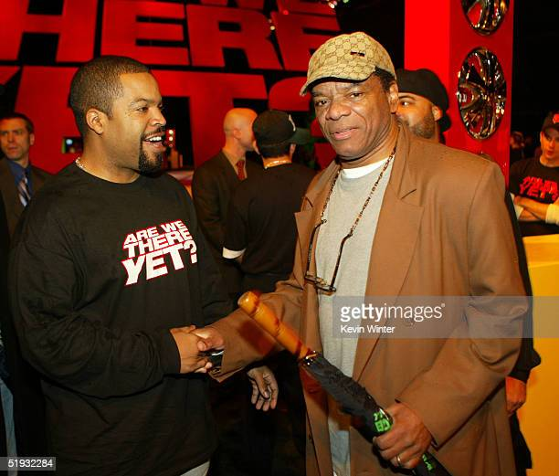 "Actors John Witherspoon and Ice Cube pose at the after party of the premiere of ""Are We There Yet"" at Barker Hanger on January 9, 2005 in Santa..."
