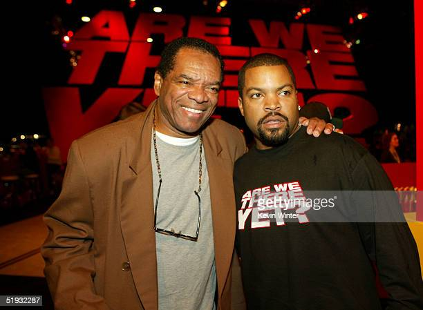 Actors John Witherspoon and Ice Cube pose at the after party of the premiere of Are We There Yet at Barker Hanger on January 9 2005 in Santa Monica...
