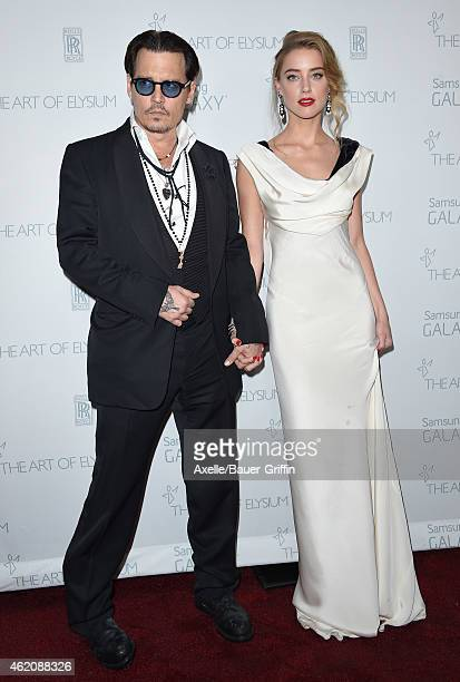 Actors Johnny Depp and Amber Heard arrive at The Art Of Elysium 8th Annual Heaven Gala at Hangar 8 on January 10, 2015 in Santa Monica, California.