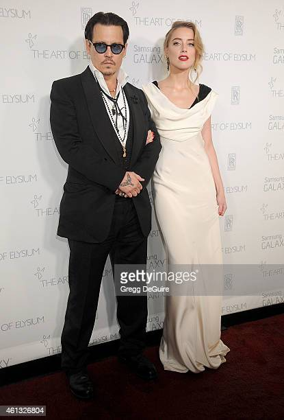 Actors Johnny Depp and Amber Heard arrive at The Art Of Elysium's 8th Annual Heaven Gala at Hangar 8 on January 10 2015 in Santa Monica California