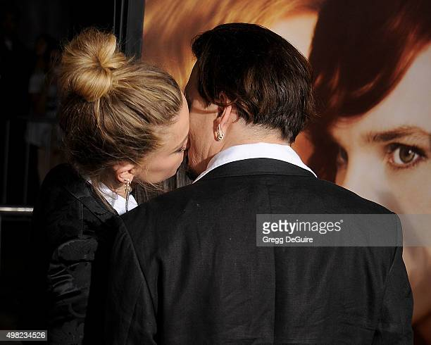 Actors Johnny Depp and Amber Heard arrive at the premiere of Focus Features' 'The Danish Girl' at Westwood Village Theatre on November 21 2015 in...