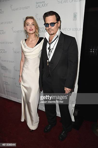 Actors Johnny Depp and Amber Heard attend the 8th Annual HEAVEN Gala presented by Art of Elysium and Samsung Galaxy at Hangar 8 on January 10 2015 in...