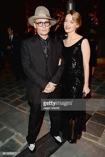 Actors Johnny Depp and Amber Heard attend The Art of Elysium's 7th Annual HEAVEN Gala presented by Mercedes-Benz at Skirball Cultural Center on...