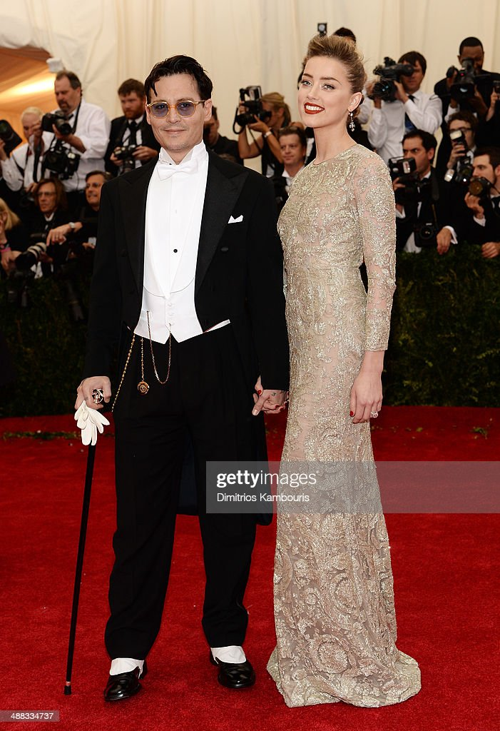 Actors Johnny Depp and Amber Heard attend the 'Charles James: Beyond Fashion' Costume Institute Gala at the Metropolitan Museum of Art on May 5, 2014 in New York City.